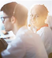 services - Businesswoman wearing headset in office Stock Photo - Premium Royalty-Freenull, Code: 6113-07243083