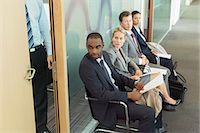 Business people sitting in waiting area Stock Photo - Premium Royalty-Freenull, Code: 6113-07243097