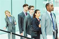 Business people waiting in line Stock Photo - Premium Royalty-Freenull, Code: 6113-07243240