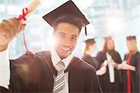 Smiling graduate holding diploma Stock Photo - Premium Royalty-Freenull, Code: 6113-07243272
