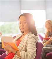 University student reading in lounge Stock Photo - Premium Royalty-Freenull, Code: 6113-07243351