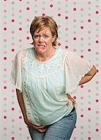 Uneasy pregnant woman with pains on polka dot background Stock Photo - Royalty-Freenull, Code: 400-07245511