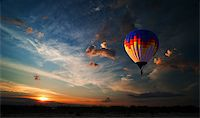 Colorful hot air balloon is flying at sunrise Stock Photo - Royalty-Freenull, Code: 400-07248877