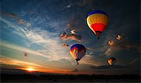 Colorful hot air balloon is flying at sunrise Stock Photo - Royalty-Freenull, Code: 400-07248879