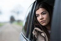 sad girls - Portrait of young woman sitting inside car and looking out of window and day dreaming on overcast day, Germany Stock Photo - Premium Royalty-Freenull, Code: 600-07278923