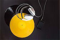 Vinyl record, headphones and mp3 player Stock Photo - Premium Royalty-Freenull, Code: 649-07279630