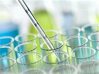 A graduated pipette being inserted into test tube Stock Photo - Premium Royalty-Freenull, Code: 649-07279794