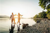 Young couple paddling in lake, Cumbria, England, UK Stock Photo - Premium Royalty-Freenull, Code: 649-07279917