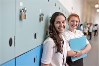 school girl uniforms - Portrait of teenage schoolgirls in corridor Stock Photo - Premium Royalty-Freenull, Code: 649-07280047