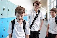 Schoolboy being bullied in school corridor Stock Photo - Premium Royalty-Freenull, Code: 649-07280054