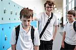 Schoolboy being bullied in school corridor Stock Photo - Premium Royalty-Freenull, Code: 649-07280054