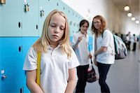 school girl uniforms - Schoolgirl being bullied in school corridor Stock Photo - Premium Royalty-Freenull, Code: 649-07280055