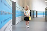 school girl uniforms - Unhappy schoolgirl walking alone in school corridor Stock Photo - Premium Royalty-Freenull, Code: 649-07280057