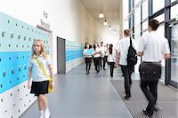 school girl uniforms - Unhappy schoolgirl walking in school corridor Stock Photo - Premium Royalty-Freenull, Code: 649-07280058