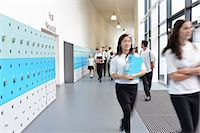 school girl uniforms - Schoolchildren walking through school corridor Stock Photo - Premium Royalty-Freenull, Code: 649-07280059