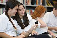 school girl uniforms - Teenagers hanging out in library Stock Photo - Premium Royalty-Freenull, Code: 649-07280083