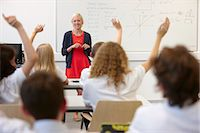 Female teacher and class with hands raised Stock Photo - Premium Royalty-Freenull, Code: 649-07280097