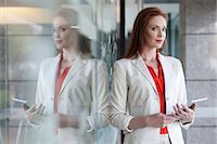 Businesswoman holding digital tablet Stock Photo - Premium Royalty-Freenull, Code: 649-07280659