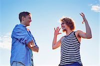 story - Two male friends enjoying conversation in sunlight Stock Photo - Premium Royalty-Freenull, Code: 649-07280973