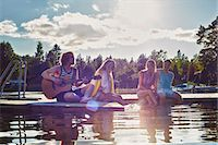 Two young couples relaxing on pier, Gavle, Sweden Stock Photo - Premium Royalty-Freenull, Code: 649-07280981