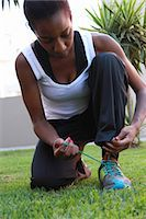 Young woman tying shoelaces, Johannesburg, South Africa Stock Photo - Premium Royalty-Freenull, Code: 682-07281299