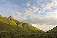 Intunja Peak with a grassy valley below, Monk's Cowl, Kwazulu-Natal, South Africa. Stock Photo - Premium Royalty-Freenull, Code: 682-07281453