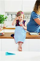 Daughter And Mother In The Kitchen Stock Photo - Premium Royalty-Freenull, Code: 6115-07282686