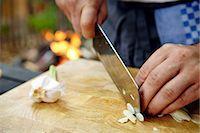 Person Cutting Garlic Stock Photo - Premium Royalty-Freenull, Code: 6115-07282738