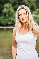 Young woman in a white shirt, portrait, Bavaria, Germany Stock Photo - Premium Royalty-Freenull, Code: 6115-07282773