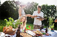 Friends barbecuing on the riverside, foothills of the Alps, Bavaria, Germany Stock Photo - Premium Royalty-Freenull, Code: 6115-07282778