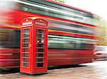 Red Phone cabine and bus in London.  Vintage phone cabine monumental