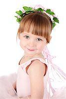 Toddler ballet girl in pink against white background Stock Photo - Royalty-Freenull, Code: 400-07302639