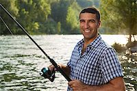 diego_cervo (artist) - mid adult fisherman on holidays on river, relaxing and fishing trouts Stock Photo - Royalty-Free, Artist: diego_cervo, Code: 400-07303888