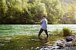 mid adult man on holidays on river, relaxing and fishing trout Stock Photo - Royalty-Free, Artist: diego_cervo, Code: 400-07303889