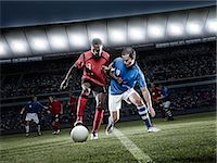 footballeur - Soccer players chasing ball on field Stock Photo - Premium Royalty-Freenull, Code: 6113-07310537