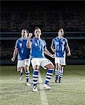 Soccer players cheering on field Stock Photo - Premium Royalty-Freenull, Code: 6113-07310540