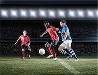 footballeur - Soccer players with ball on field Stock Photo - Premium Royalty-Freenull, Code: 6113-07310543