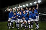 Soccer team cheering on field Stock Photo - Premium Royalty-Freenull, Code: 6113-07310549