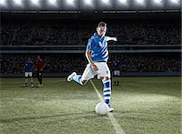soccer player (male) - Soccer player kicking ball on field Stock Photo - Premium Royalty-Freenull, Code: 6113-07310555