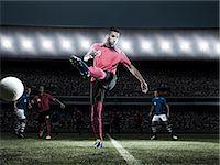 footballeur - Soccer player kicking ball on field Stock Photo - Premium Royalty-Freenull, Code: 6113-07310559