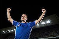 footballeur - Soccer player cheering in stadium Stock Photo - Premium Royalty-Freenull, Code: 6113-07310562