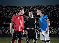 footballeur - Soccer players facing each other on field Stock Photo - Premium Royalty-Freenull, Code: 6113-07310564
