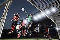 footballeur - Soccer players defending goal Stock Photo - Premium Royalty-Freenull, Code: 6113-07310576