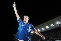 footballeur - Soccer player cheering in stadium Stock Photo - Premium Royalty-Freenull, Code: 6113-07310579