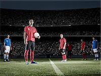 footballeur - Soccer player holding ball on field Stock Photo - Premium Royalty-Freenull, Code: 6113-07310586