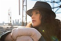 Close-up portrait of teenage girl outdoors, wearing fedora and looking into the distance, Germany Stock Photo - Premium Royalty-Freenull, Code: 600-07310994