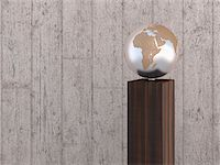 Illustration of metal globe on wooden stand, showing Africa, Europe and Asia, studio shot on grey, wooden background Stock Photo - Premium Royalty-Freenull, Code: 600-07311007