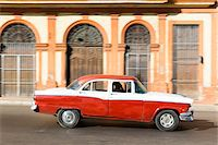 Vintage car in front of historic architecture, Havana, Cuba Stock Photo - Premium Royalty-Freenull, Code: 600-07311168