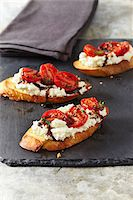 Appetizer of Ricotta and Tomatoes on Bread, Studio Shot Stock Photo - Premium Royalty-Freenull, Code: 600-07311279