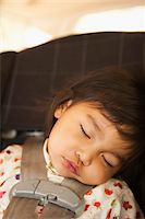 Close-up of toddler girl sleeping in child safety seat, USA Stock Photo - Premium Rights-Managednull, Code: 700-07311591